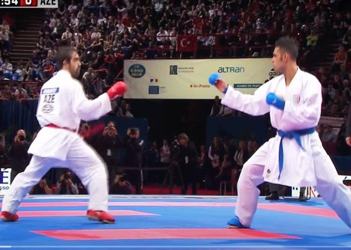 dos personas disputando tipos de artes marciales