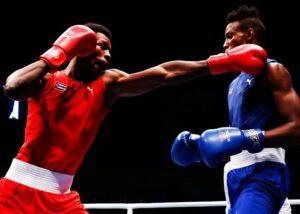 personas peleando por categorias de boxeo por peso